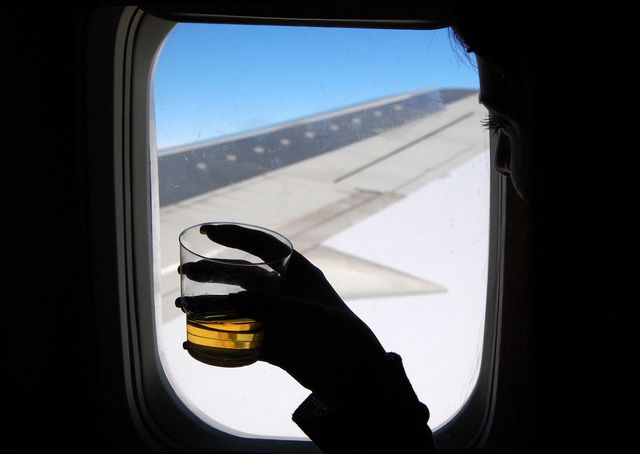Drinks on a Plane - When and where is it okay to drink in an airport or on a plane? featured image