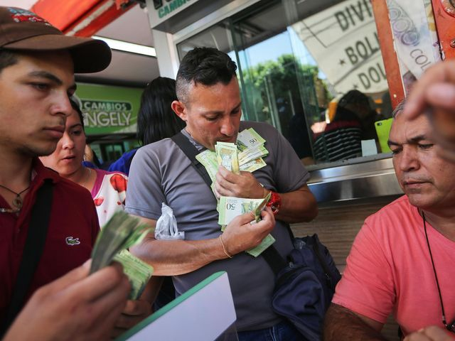 Venezuela's currency now worth so little shopkeepers weigh vast piles of notes instead of counting t featured image