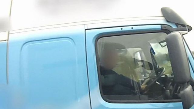 HGV Driver cleaning teeth behind the wheel!!! featured image