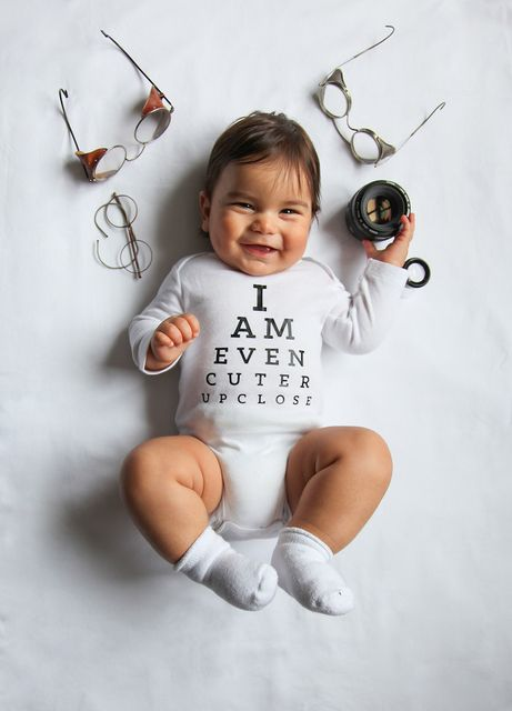 Adorable baby in pun-filled onesies featured image