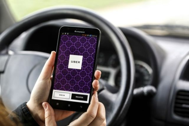 Uber rolls out insurance plan for couriers with AXA featured image