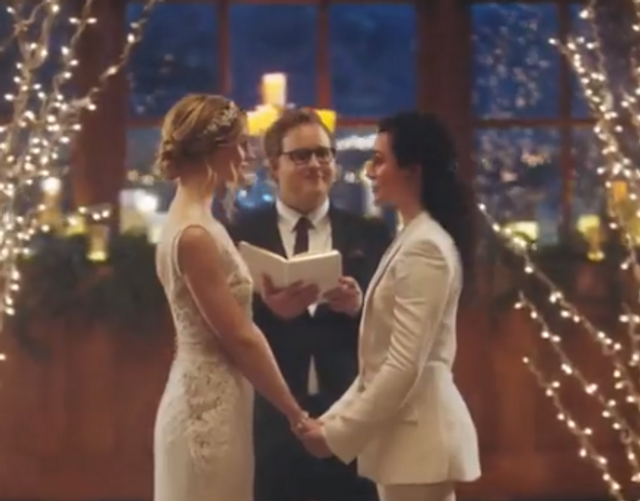 Hallmark Apologizes for Pulling Commercials That Show Brides Kissing featured image