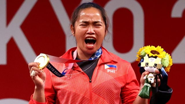 With a flick of the wrist, Hidilyn Diaz lifts the spirit of a struggling nation... featured image