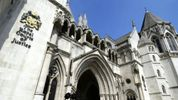 Restrictive covenant not modified to excuse development built in breach